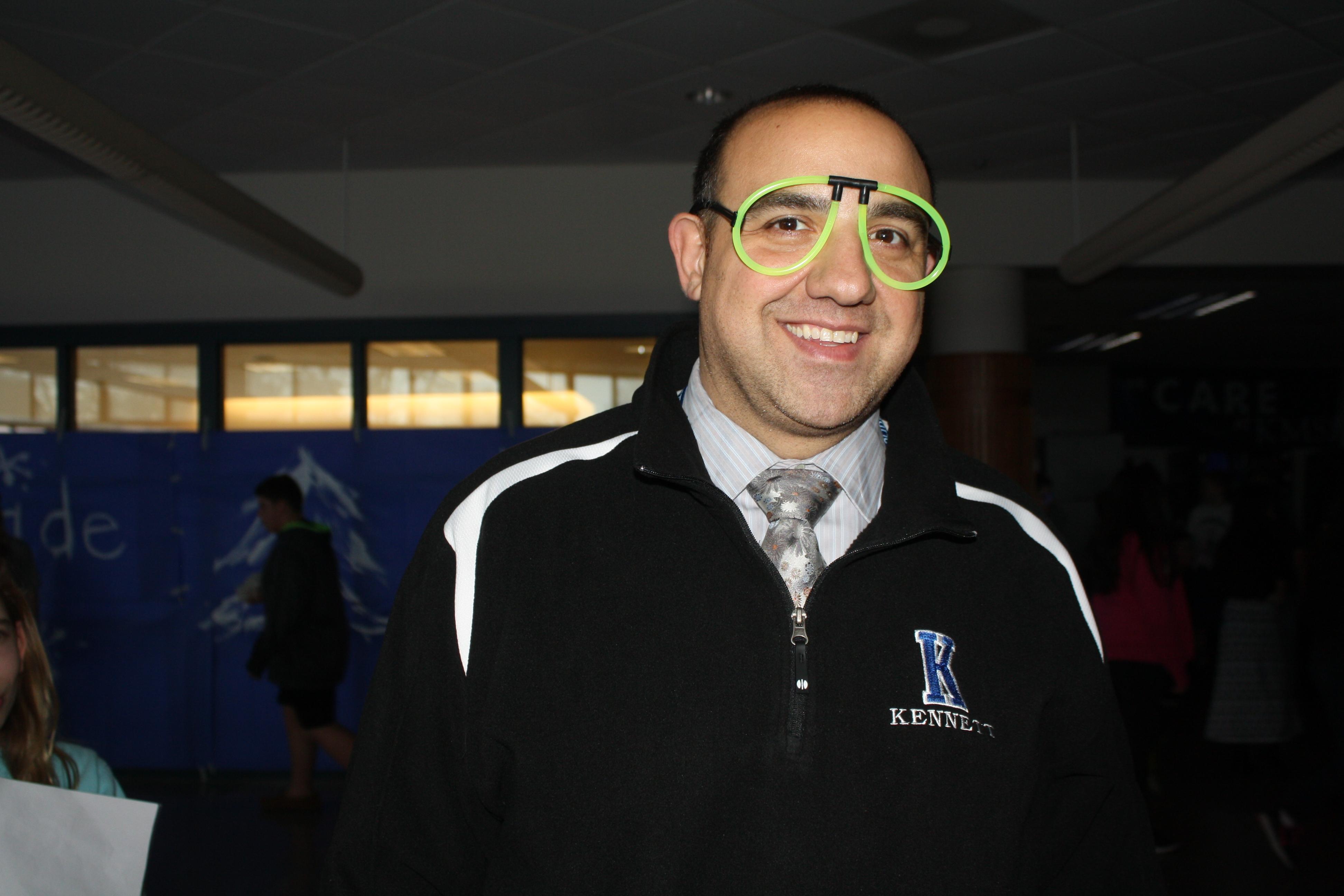 principal wearing fake glasses