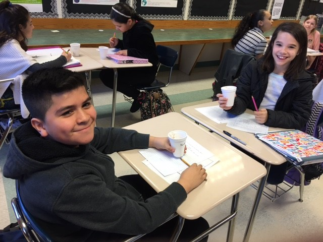 Student at desk writing