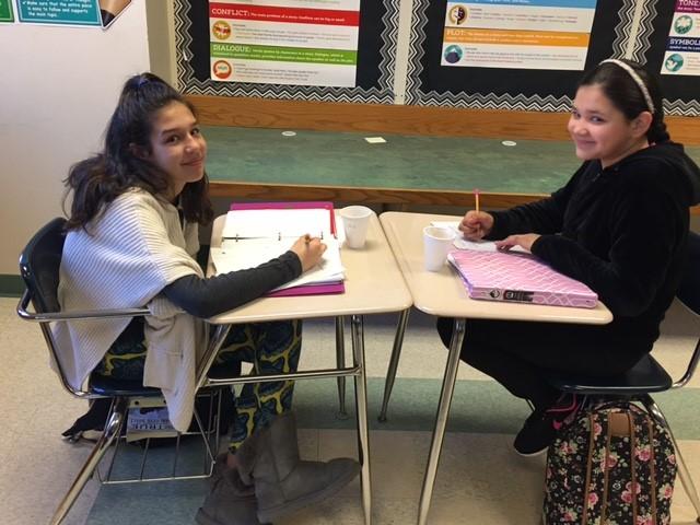 Students at desk writing